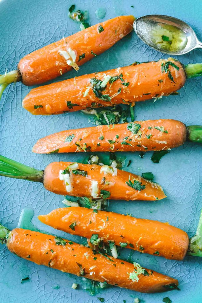 Bright orange carrots on a teal plate