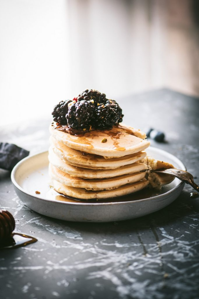 Pancake stack topped with blackberries
